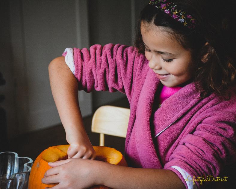 lula-June happily carving her big pumpkin for halloween